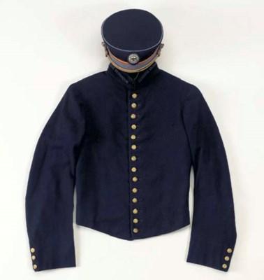 A bell boy's uniform jacket fr