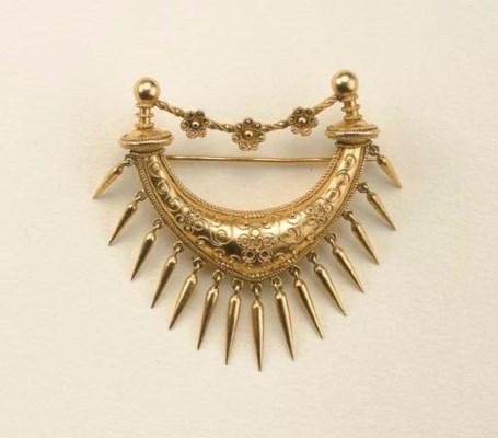 Antica spilla in oro