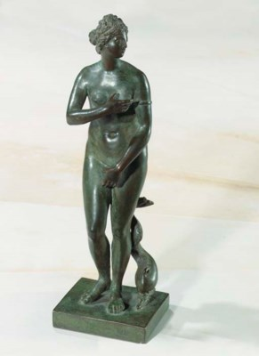 AN ITALIAN PATINATED BRONZE ST