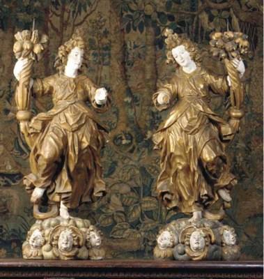 A pair of polychrome and gilt