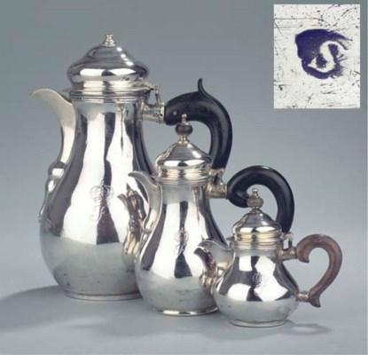 A silver three-piece coffee se