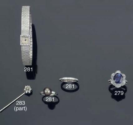 A DIAMOND STICK PIN AND AN UNM