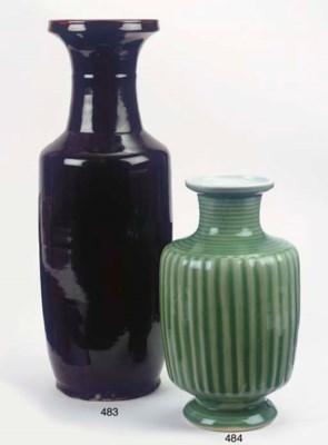 A black-glazed rouleau vase