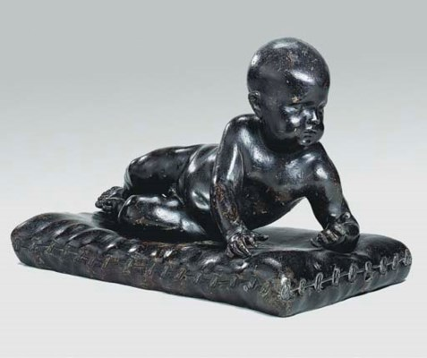 A PATINATED LEAD FIGURE OF A C