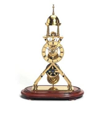 A Victorian brass and mahogany