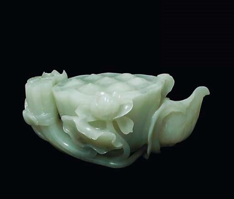 A CELADON JADE CARVING OF A LO