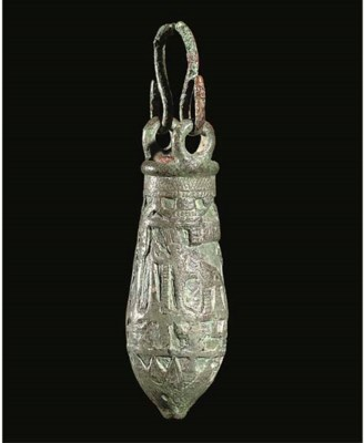AN EGYPTIAN BRONZE SITULA WITH
