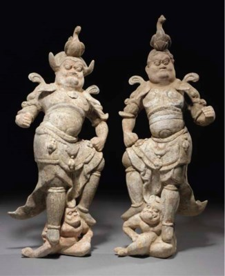 A pair of painted pottery guar