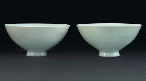 A pair of pale celadon glazed