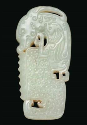 A pale celadon jade twin-horne