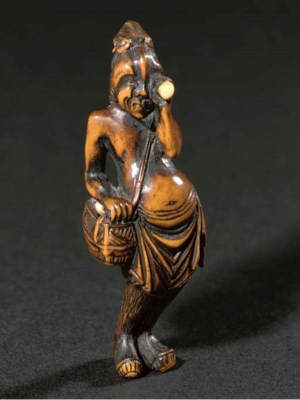 A Wood netsuke of a Foreign eg