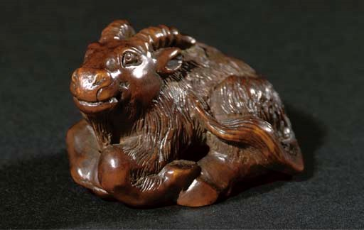 A wooden netsuke of a ram, 19t