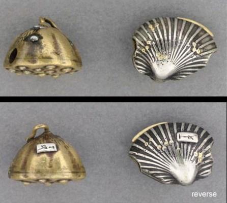 A silver ojime of a closed cla