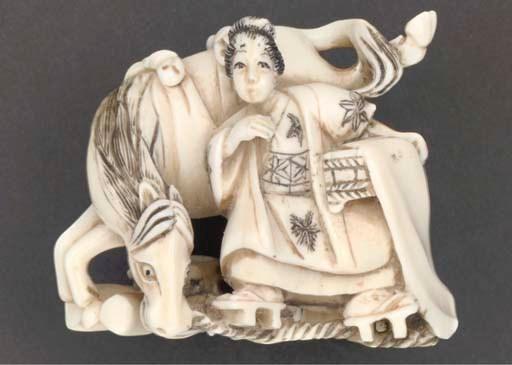 An ivory netsuke of woman stan