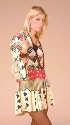 A PRINT DRESS LABELLED OSSIE C