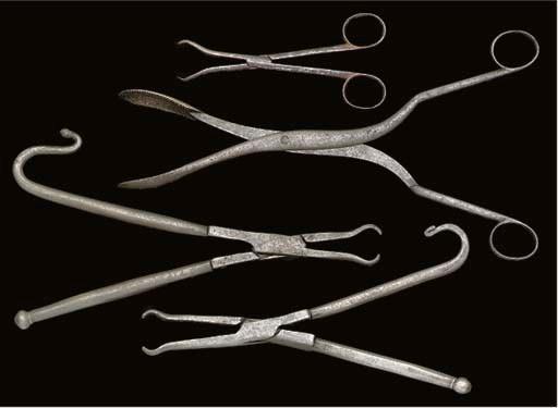 Four steel forceps,