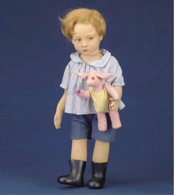 A painted felt Lenci boy doll