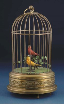 A pair of singing birds-in-cag
