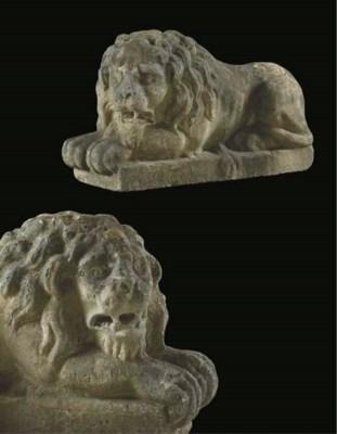 A pair of sculpted limestone m