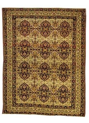 An antique Kirman Laver rug
