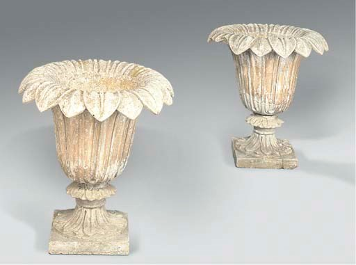 A PAIR OF ARTIFICIAL STONE URN