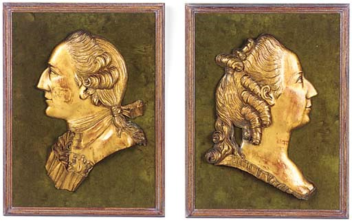A pair of gilded limewood reli