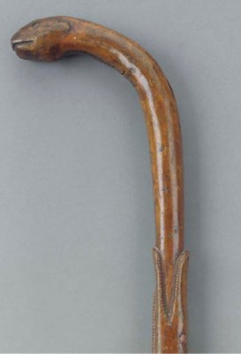 A carved wood snake and crocod