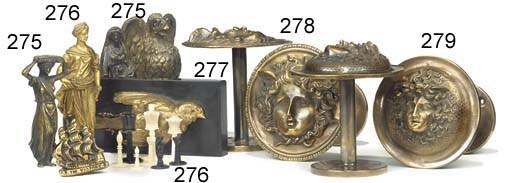 A set of four cast bronze curt