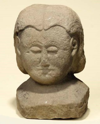 A PRIMITIVE STONE HEAD