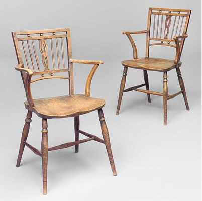A PAIR OF MENDLESHAM ARMCHAIRS