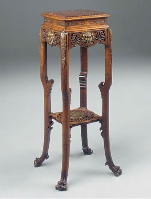 AN ORIENTAL HARDWOOD AND GILT
