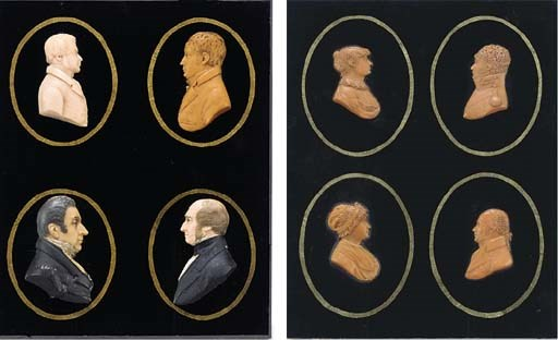 A COLLECTION OF EIGHT WAX RELI