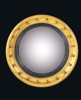 A giltwood convex mirror