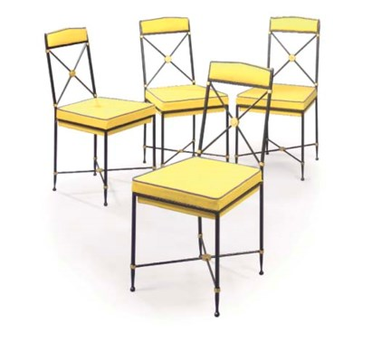 A SET OF FOUR BLACK AND GOLD P