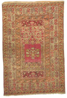 An antique Ghiordes prayer rug