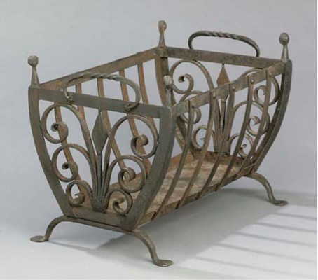 A WROUGHT IRON BASKET GRATE