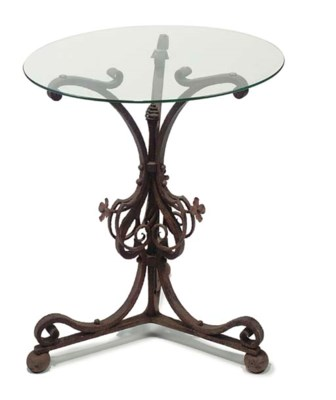 A WROUGHT IRON TABLE BASE