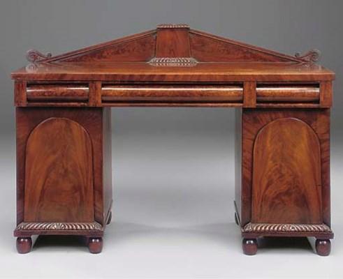 A mahogany pedestal desk