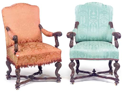 A MATCHED PAIR OF CARVED WALNU