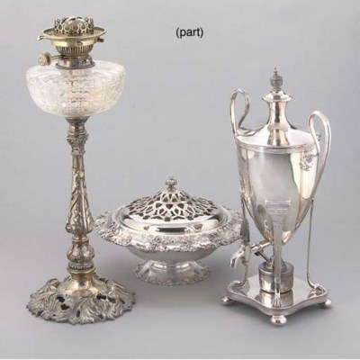 A PLATED OIL LAMP WITH GLOBE A
