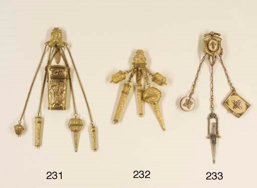 A GILT-METAL CHATELAINE CLIP