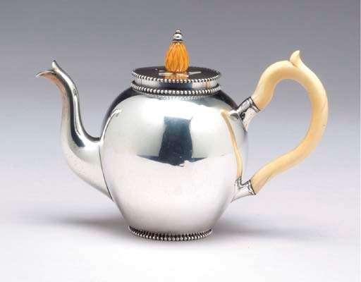 A DUTCH SILVER TEAPOT**,