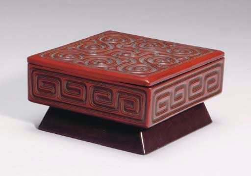 A JAPANESE CARVED RED GURI STY