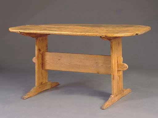 A PINE TRESTLE TABLE,