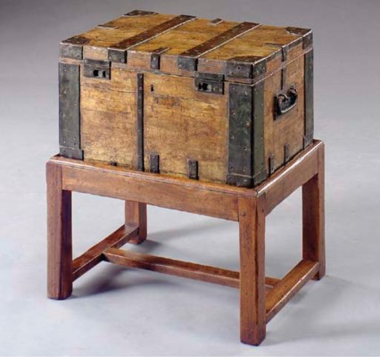 AN IRON BOUND WOODEN TRUNK ON