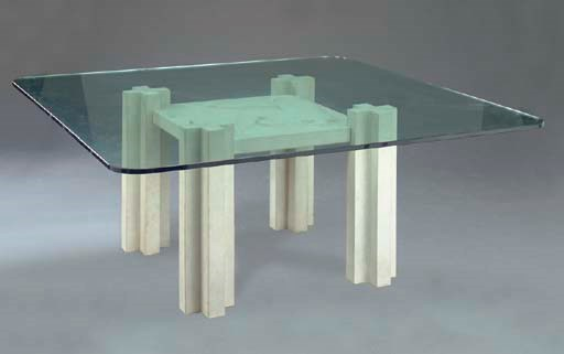 A CARVED STONE AND GLASS TABLE