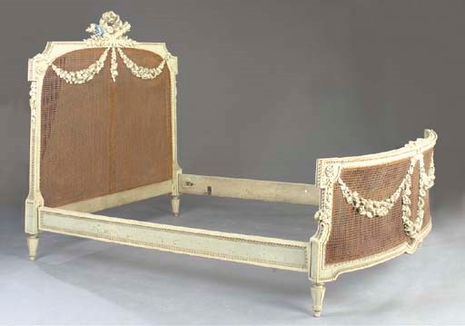 A LOUIS XVI STYLE CARVED AND C