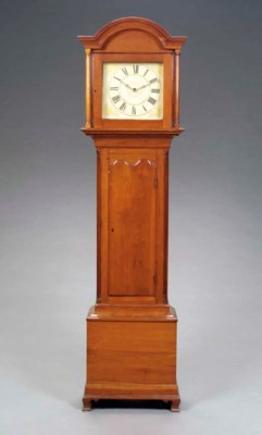 A CHIPPENDALE CHERRYWOOD TALL