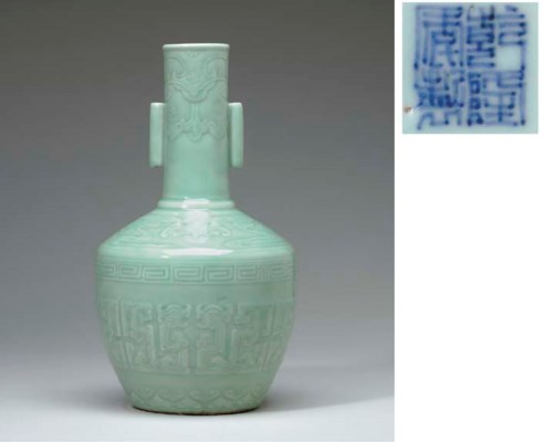 A CELADON-GLAZED CARVED VASE
