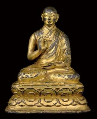 A Gilt Bronze Figure of a Lama